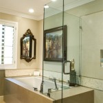 Tub & shower integration with stone deck bench and glass shower walls