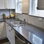 Carrera brick backsplash, black granite counter, brushed stainless fixtures